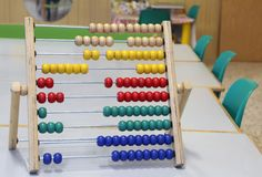 Abacus to learn how to count numbers in decimal or base ten. Wooden abacus to learn how to count numbers in decimal or base ten stock image