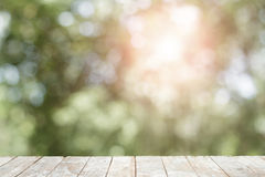 Wooden with abstract bokeh background. Lens flare effect. Stock Image