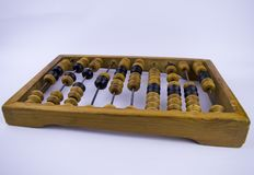 Wooden accounts for arithmetic calculations on a white background. Old royalty free stock photos