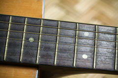 Wooden acoustic guitar bar. detail of classic guitar Royalty Free Stock Photography
