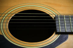Wooden acoustic guitar bar. detail of classic guitar Royalty Free Stock Photos