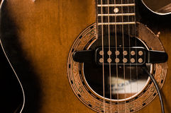 Wooden acoustic guitar with electric pickup. Wooden acoustic guitar with an electronic pickup for connecting to an amplifier Royalty Free Stock Photo