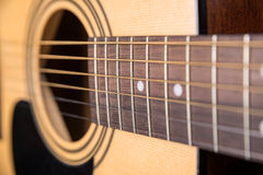 Wooden acoustic guitar isolated with a large horizontal plan Royalty Free Stock Photography