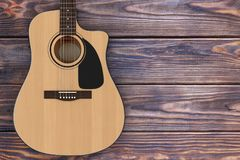 Wooden Acoustic Guitar. 3d Rendering. Wooden Acoustic Guitar on a wooden table. 3d Rendering Royalty Free Stock Photography