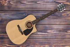 Wooden Acoustic Guitar. 3d Rendering. Wooden Acoustic Guitar on a wooden table. 3d Rendering Stock Image