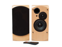 Wooden acoustic system with remote. Wooden acoustic system with black speakers and remote control isolated on white background Royalty Free Stock Photo