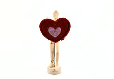Wooden action figure with heart Stock Photos