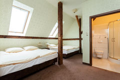 Wooden addition in a shared room Stock Images
