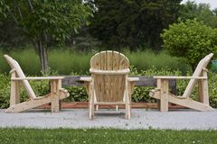 Wooden Adirondack Chairs Waiting for a Picnic Stock Image
