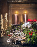 Wooden Advent wreath with burning candles on dark wooden background Stock Photo