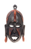 African wooden mask. Wooden African tribal mask isolated on a white background Royalty Free Stock Photo