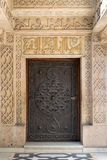 Wooden aged door with ornate bronzed floral patterns at the public mosque of Prince Mohammed Ali Tewfik Palace, Cairo, Egypt. Closed wooden aged door with ornate stock image