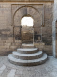 Wooden aged vaulted open door, three steps and stone wall Royalty Free Stock Photos