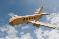 Wooden airplane flying in the sky Stock Photos