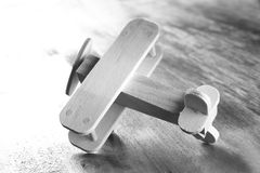 Wooden airplane toy over textured wooden background. retro style image. black and white old style photo stock photos
