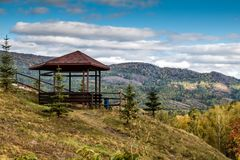 Wooden alcove in the mountains. Wooden alcove in the autumn mountains Royalty Free Stock Image