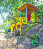 The wooden alcove on Rumassala Mount. The statue of Hanuman on Rumassala Mount, due to legend, he created this mountain, dropped here chunk of Himalaya royalty free stock photography