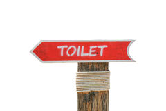 Wooden allow pointer toilet sign for background or text Royalty Free Stock Photos