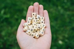 Wooden alphabet beads Stock Photo