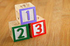 123 wooden alphabet block. On the wooden background Royalty Free Stock Photography