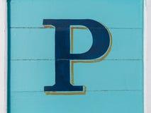 Wooden alphabet block, letter P. Blue wooden alphabet block, letter P Stock Images