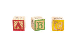 Wooden alphabet blocks isolated Stock Images