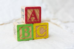 Wooden Alphabet Blocks on Quilt Spelling ABC Stacked Royalty Free Stock Photo