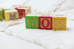 Wooden Alphabet Blocks on Quilt Spelling Boy Angled Royalty Free Stock Photography