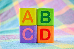 Wooden alphabet blocks toy Stock Photos