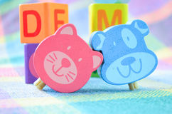 Wooden alphabet blocks toy. On a colorful background Stock Photos