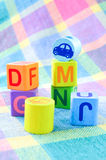 Wooden alphabet blocks toy. On a colorful background Royalty Free Stock Images