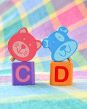 Wooden alphabet blocks toy. On a colorful background Royalty Free Stock Image
