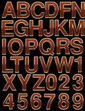 Wooden alphabet with gold. On black Royalty Free Stock Photo