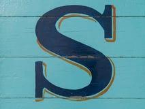Wooden alphabet , letter S. Wooden alphabet block, letter S Stock Photography
