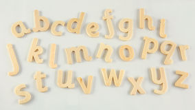 Wooden alphabet letters. Alphabet letters in blond wood on white background royalty free stock image