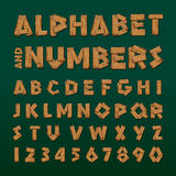 Wooden alphabet and numbers. Vector eps10 illustration Stock Photos