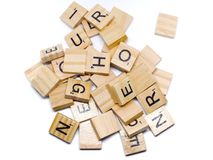 The wooden alphabets with a black letters on the brown wood, this image on white background. For wallpaper, display or backdrop stock photography