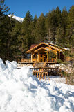 Wooden alpine chalet in the mountains Royalty Free Stock Photography