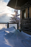 Wooden alpine chalet in the winter nature Royalty Free Stock Photography