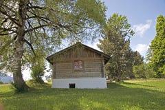 Wooden alpine house Stock Photo