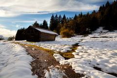 Wooden alpine hut in sunset light Royalty Free Stock Photo