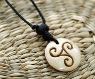 Wooden amulet Stock Images