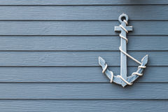 Wooden anchor. On wall background royalty free stock photos