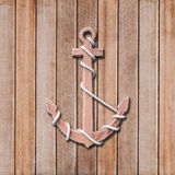 Wooden anchor. On wall background royalty free stock photo