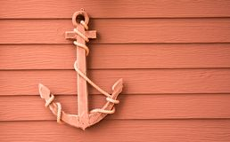 Wooden anchor on wall background. Wooden anchor on wall vintage background stock photos