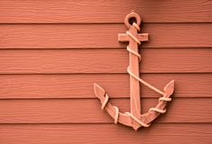 Wooden anchor on wall background. Wooden anchor on wall vintage background royalty free stock image