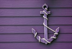 Wooden anchor on wall background. Wooden anchor on wall vintage background royalty free stock images