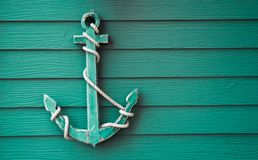 Wooden anchor on wall background. Wooden anchor on wall vintage background stock image