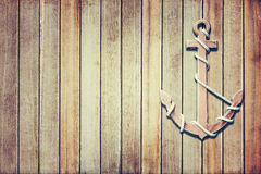 Wooden anchor. On wall background, in vintage style royalty free stock photography