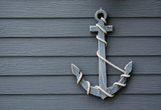Wooden anchor on wall background. Wooden anchor on wall vintage background stock photo